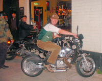 Seth Pitt astride a cow-hide clad motorbike outside the Cat & Wheel in Bristol