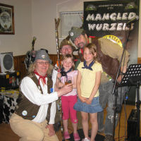 The Mangledwurzels posing with two new fans at Bucklegrove Caravan Park (13 May 2010))