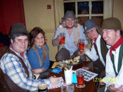 Daisy Cutter and Rosie Russet help out the band at the R.I.C.E. Charity Quiz at the Red Lion, Bath